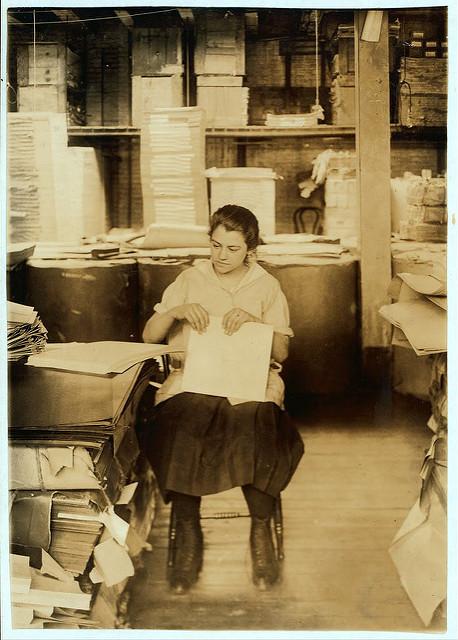 Folding filling-folders. Taken 1917. Boston, MA. Lewis Hine, photographer